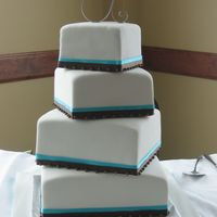 Turquoise And Chocolate Fondant covered square cakes trimmed with ribbons and edible chocolate fondant pearls. Cake sizes 12,10,8 and 6. With such a simple design...