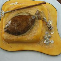 Southern Flounder The flounder is made of a thin slice of cake cover with fondant and airbrushed. I learned the finer points of flounder identification with...