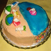 Mice On The Beach My daughter (9) made this cake by herself as a summer time project. The mice and umbrellas were made from fondant and gumpaste. The water...