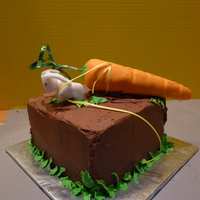 Bunny Cake For a school Easter party. Bunny dragging a giant carrot. Bunny handformed with fondant. Carrot made from Rice Krispie Treats and wrapped...