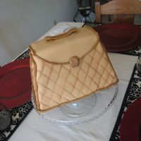 Leather Box Purse Vanilla cake with french vanilla buttercream.I was going for a quilted leather effect with the fondant.