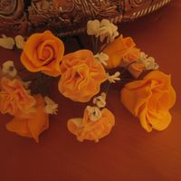 Orange Flowers My first gumpaste flowers. A mix of carnations, roses, and baby's breath. Ty for looking!