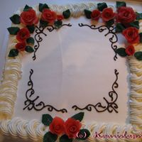 Whipped Cream Birhday Cake This cake is covered with a whipped cream and decorated with a marzipan roses and chocolate pipings. This was for my grandmom's sister...