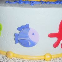 Baby Shower Fondant Figures - Close Up A close up of some of the fondant cutout figures. I used marbelized fondant for the fish. Wish my camera angle would have been able to...