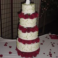 Trisha's Cake - Full View 4-flavor cake with BC icing, with 6 dozen fresh roses.