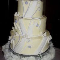 Elizabeth And Troy  3-tier BC iced wedding cake with funky fondant accents to match wedding colors, and gumpaste butterflies. This is a knockoff of a cake the...