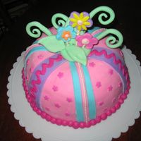 Pink Whimsical Cake i was told to make a girly cake with lots of pink. this is what i came up with. the bday girl loved it. marble cake with buttercream...