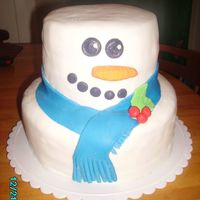 Snowman this cake turned out soooo cute! loved making it. butter cake with buttercream frosting and mmf.