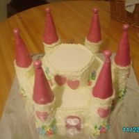 Princess Castle Cake this cake was made with buttercream icing and satin ice fondant. painted with pink and white pearl dust. it was sooo cute.