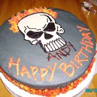 Pict1176.jpg i made this cake for my bro n law.....he's a rough n tough guy so i thought he'd like the skull and flames. i was right he did. i...