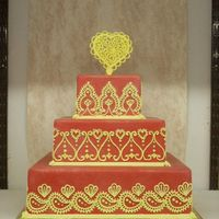 Deerfield Fair 2008 This is a dummy cake I submitted to the Deerfield (NH) fair in 2008. It won first place in the wedding cake class. Red fondant and royal...