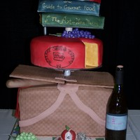 Food And Wine Expo Contest Cake This was a cake we did for the Premier Food and Wine Expo. Everything on the cake is 100% edible!! Basket, cheese, books are cake. Plates...