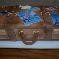 Suitcase Cake 3D leather Suitcase cake complete with edible photos of her travels to 9+ countries. Complete with edible passport and hand scupted...