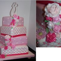 Square Off Center Pink Quilted Wedding Cake Quilted pattern with pink luster dust brushed inside the quilt lines, irridescent pearls, gumpaste gerbera daisies and roses.