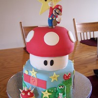 Super Mario Brothers Super Mario Brothers Cake with more of the classic mario brothers look. All edible, hand sculpted gumpaste figures.