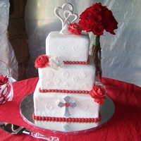 Square Wedding Cake 3 Tier Square wedding cake with gumpaste roses, fondant pearls and cross to match Groom's Tattoo.