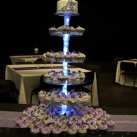 Cupcake Tower Cupcake wedding tower with bridal cake on top and lavender and metallic silver cupcakes with gumpaste flower and monogram chocolate.
