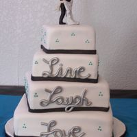 Live, Laugh, Love 4 tier off center square wedding cake. Live, Laugh, Love in gumpaste and airbrushed metallic silver.