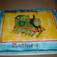 Thomas The Train This cake was made for my cousin's 3 year old. I took the design off of the invintation. The only mistake was I sprayed the background...