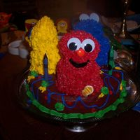 Elmo, Cookie Monster, Big Bird Seame Street Cake Cake was made using Wilton 3D mini bear pan for characters