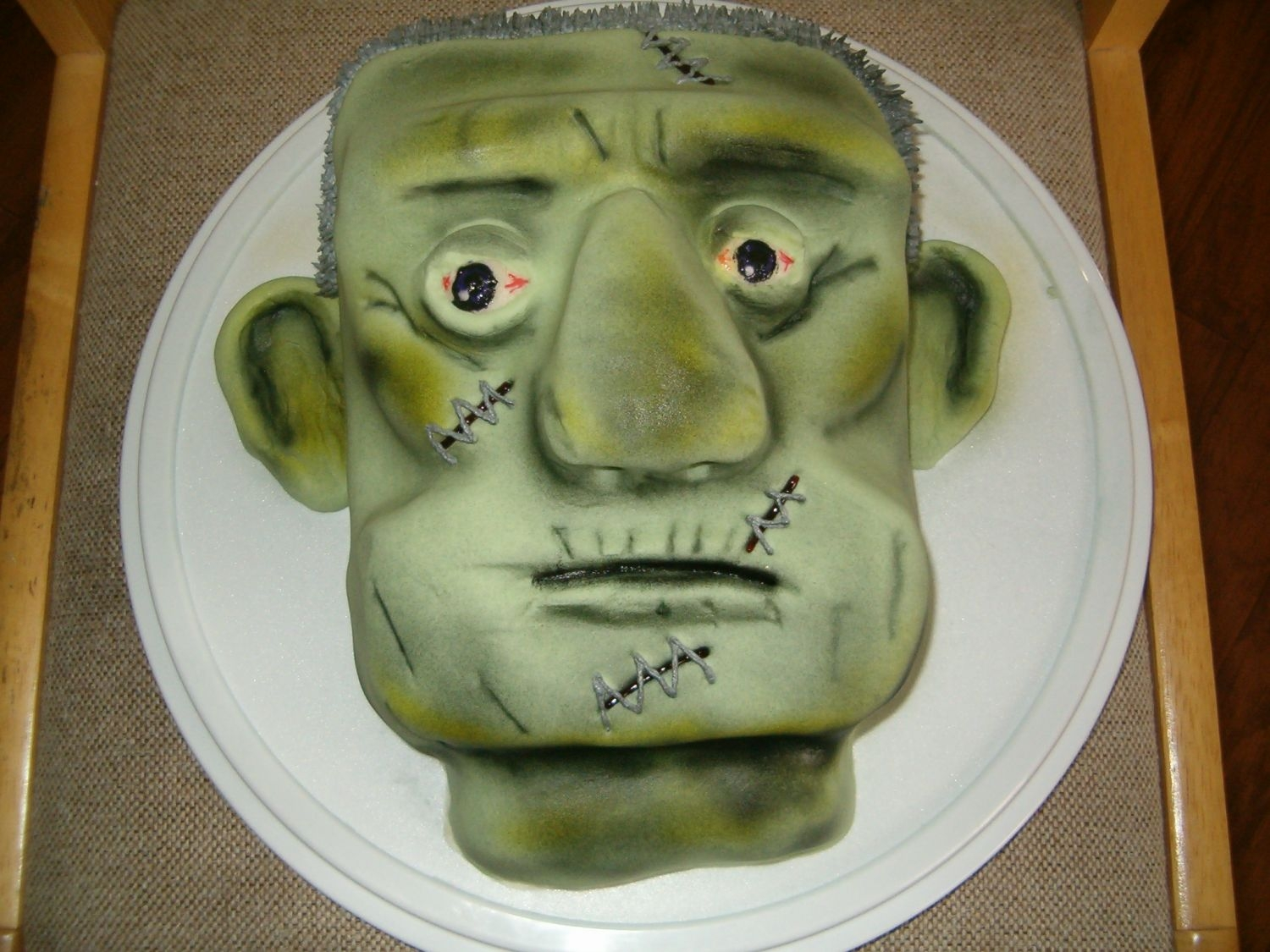 Frankenstein   Yellow cake filled & frosted w/buttercream & finished in fondant & airbrushed.