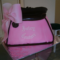 Juicy Couture Purse Cake Pound Cake w/ Strawberry Filling. Covered w/ Fondant.