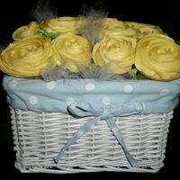 Yellow Rose Cupcake Basket This was for a baby shower. There are a dozen cupcakes tucked neatly into this basket. (Hobby Lobby has the cutest containers!) I used 1M...