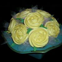 Yellow Rose Cupcake Bouquet  This is my very first cupcake bouquet!!! It came together just how I had hoped! I love it when that happens!!! I had to keep telling people...