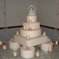 Precious Candlelit Moments This was one that I did this for my little brother's wedding in June. It's a multi-tiered display cake covered in white fondant...