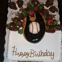 Baseball_Glove_Cake.jpg Got this idea from someone on here! Thanks! It was vanilla cake with strawberry filling in the middle. My husband made the glove and the...