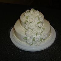 Course 3 Tiered Wedding Cake This was my first wedding cake. It was made for Wilton Course 3. It is a Lemon cake with buttercream icing and fondant roses.