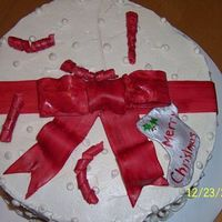 Holiday Cake Red velvet cake w/ fluffy white frosting. I wasn't too happy w/ how the bow turned out but it tasted awesome. My first time using...