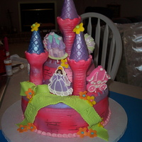 Lexi's Cake   ROLLED FONDANT, CHOCOLATE SUCKERS, WILTON CASTLE SET COVERED IN ROLLED FONDANT