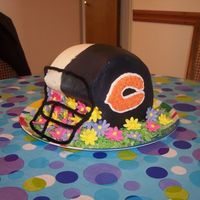 Bears/colts Super Bowl Cake  I made this helmet cake for a Super Bowl party I went to. Devils food cake, carved to helmet shape, iced in buttercream, royal flowers. I&#...