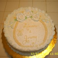 S4010215.jpg This was actually an engagement cake. Cream cheese icing and burttercream roses.