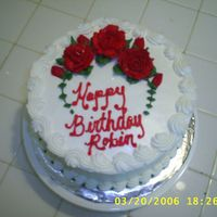 S4010307.jpg Just a simple birthday cake. Buttercream roses. Love the Americolor Super Red; makes life so much easier.
