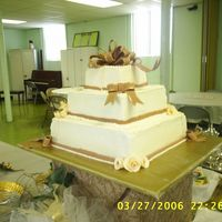 S4010310.jpg My first stacked wedding cake. Also my first shot at gumpaste roses and ribbons. I was a ball of nerves with this cake! It wasn't what...