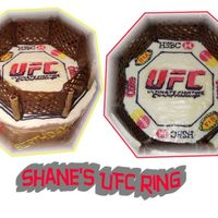 Ufc Ring Made for my boss who loves Ultimate Fighting. The logos all have significance to him & the cage is made out of chocolate & the...