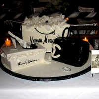 Fashionista Cake   Three cakes: NM bag, CC purse, shoebox. GP items include shoe, jewelry. Isomalt jewels.
