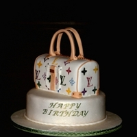 Lv Purse Cake Birthday cake topped with LV purse cake. Gumpaste handles, LV logo stenciled using airbrush.