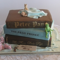 Fairy Tale Baby Shower Cake Stacked books (3 flavors), gumpaste dog, pigs, frog, baby and blanket.