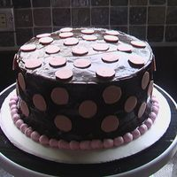 Birthday Cake Choc cake, choc ganache, choc polka dots and BC border. First time working with ganache, what a pain!