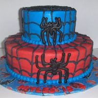 Spiderman Web Cake With Chocolate Spiders  Spidey cake iced in buttercream with buttercream web and chocolate spiders. A chocolate transfer was used for the spiderman head topper but...