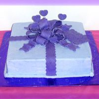 Birthday Package 12 inch squares iced in buttercream with mmf bow, hearts and gifttag. The colors weredifferent shades of purple but my camera shows blue.