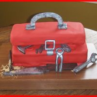 "Toolbox Groom's Cake Toolbox made from 2 12"" cakes cut in half. The bottom are 3 stacked layers and the top is one layer on its own board covered in..."