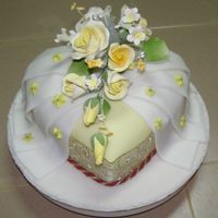 Fondant Gift Cake  1kilogram heart-shaped chocolate cake covered in yellow & white fondanntstore-bought gumpaste flowers & ribbons. design based on a...