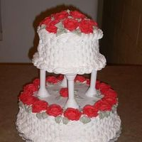 "Two-Tiered Cake With Basketweave And Pink Roses I made this cake for my parents' 40th anniversary party. It is a variation on the ""Pansy Basket"" cake from the 1997 yearbook..."