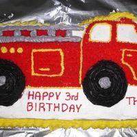 Firetruck Cake White cake made with the Wilton Fire Truck pan and frosted with Wilton colored icing (the kind sold in tubes).