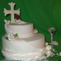 First Communion I made this for a friends daughter. Got the idea from a picture on here by janpolycarp. The cross is white chocolate, from a template, the...