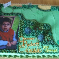 Conner Puckett Classic made for an annual fundraiser for a little boy. he is the one in the picture. this was my first full sheet cake. they requested it be as 3D...